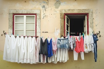 Clothes Hanging On Clothesline Against Window