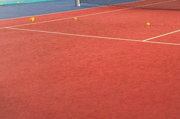 Balls On Clay Tennis Court
