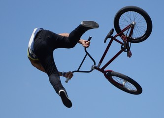 Low Angle View Of Man With Bicycle Performing A Stunt