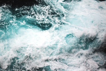 High angle view of flowing water in sea