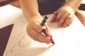 Boy Drawing With Crayons