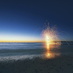 Wire wool spinning in sea at dusk