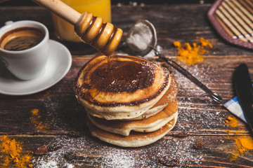 Pancakes with berries and maple syrup or honey