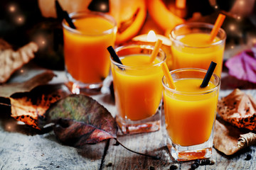 Halloween cocktail, pumpkin orange drink with spices. Dark vinta