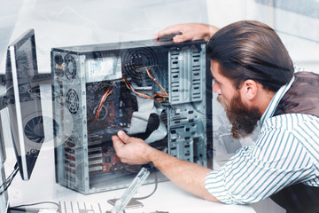 Engineer disassembling CPU, double exposure. Close-up of bearded repairman fixing computer unit