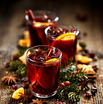 Christmas mulled red wine in a glass on a wooden table
