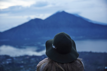 Rear view of woman looking at mountain during dawn