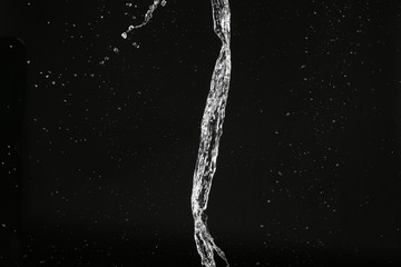Water splash. Close up. Black background