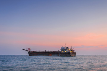 Cargo ship with Sunset.