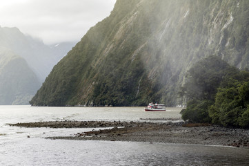 Tourist boat cruises in the fjord of Milford Sound, South island of New Zealand