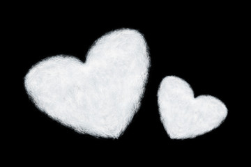two heart shaped clouds isolated on black