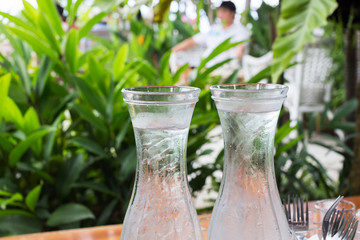 Two bottles of cold water on a table at the garden cafe