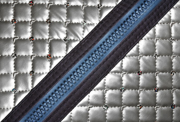 silver leather texture with diagonal zipper