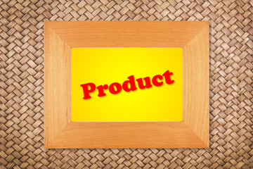 product text in modern picture frame on rattan