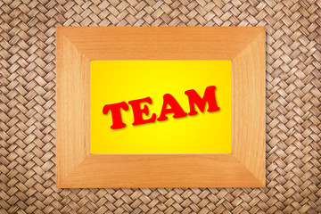 team text in modern picture frame on rattan