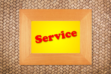 service text in modern picture frame on rattan