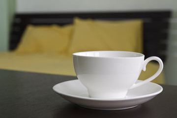 hot coffee or tea on table in bedroom