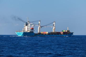 Cargo ship sails on the sea