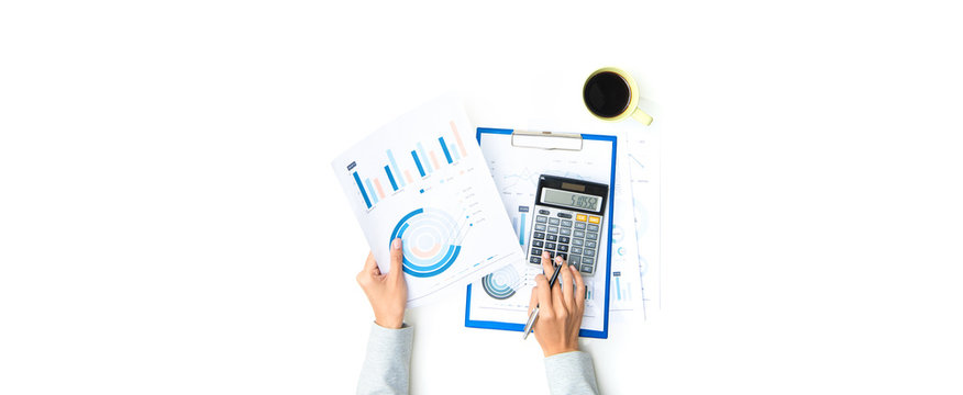Woman hands working with documents and calculator on the table - banner background