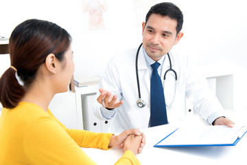 Doctor consulting with young woman