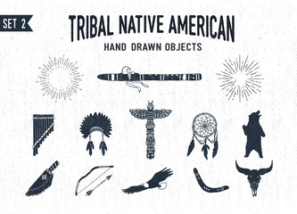 Hand drawn tribal icons set with flutes, headdress, totem pole, dream catcher, grizzly bear, knife, bow, eagle, boomerang, and buffalo skull vector illustrations.