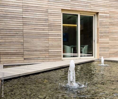 Fontane davanti a edificio in legno stock photo and for Fontane in legno
