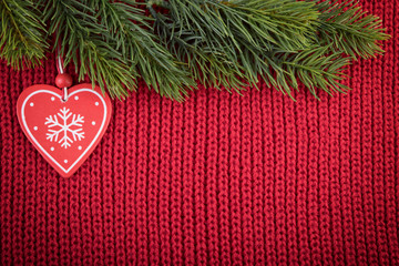 Christmas red wool background with traditional tree decoration in a farmhouse style