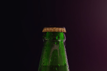 Beer Bottle with Droplet in the Dark Light, Fresh Cold Beer
