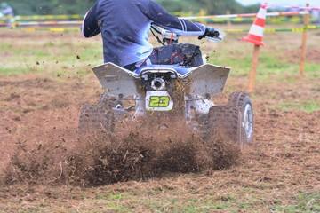 Rider on a quad motorbike.