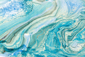 Blue marbling texture. Creative background with abstract oil painted waves handmade surface. Liquid paint.