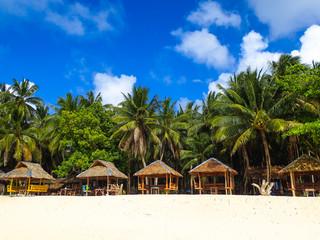 Bamboo Island Huts Lining Tropical Palm Tree Beach - Siargao, Mindanao - Philippines
