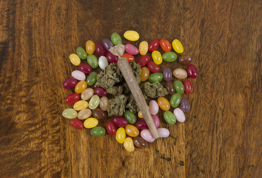 Jellybeans and Cannabis sativa, prepared for munchies while smoking weed joint
