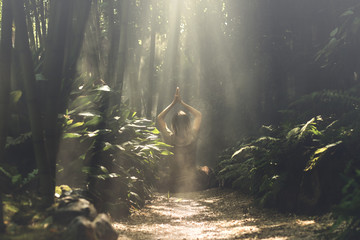 woman meditating in a bamboo forest