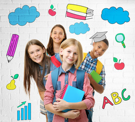 Group of cute children with drawings on background. School concept.