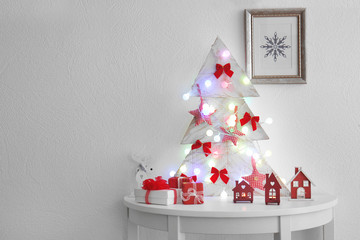 Decorated handmade Christmas tree on white table
