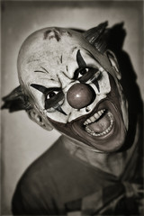 scary evil clown in sepia toning