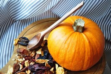 Kitchen still life pumpkin with dried fruits