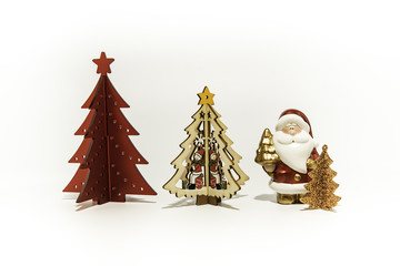 Three Christmas trees with Santa Claus isolated on white background