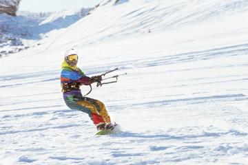 Snowboarder girl kiting snowboarding sports