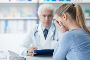 Woman receiving bad news from her doctor
