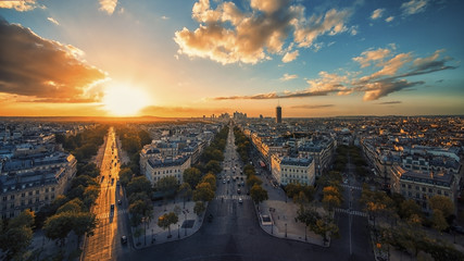 Fototapete - Sunset over Champs-Elysees and La Defense in Paris