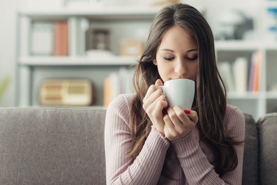 Girl having a coffee at home