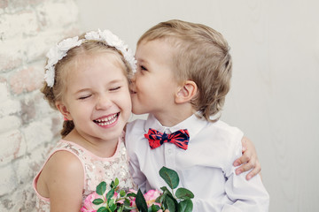 Happy little children embrace and kiss