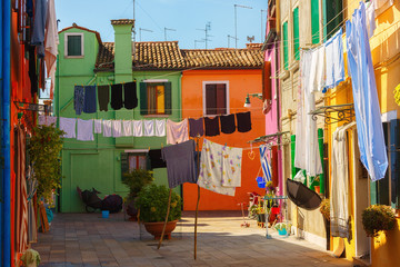 Exterior of colorful houses of Burano Island in Venice.Windows,walls,laundries,flowers and even umbrellas reflects the culture of the people in the island.
