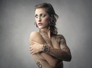 Naked tattooed woman
