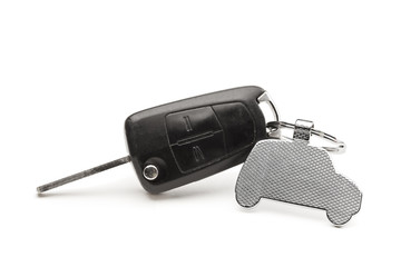 Car key with a key ring in the form of a car