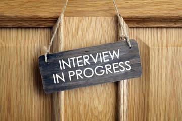 Interview in progress sign on office door