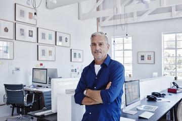 Portrait of confident businessman in office