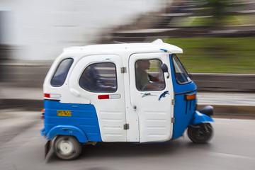 Minitaxi in Fahrt
