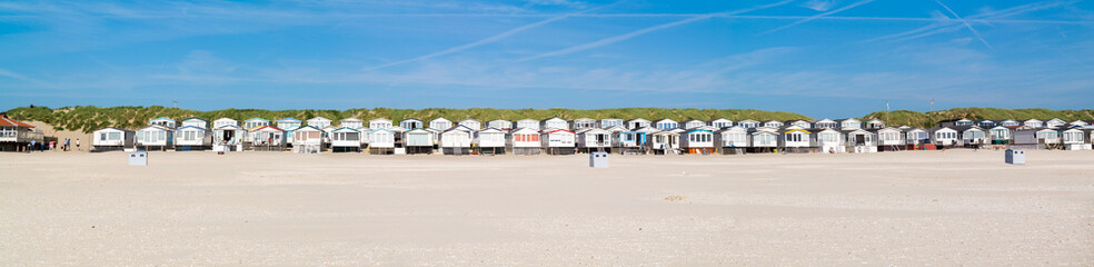 Row of beach houses or huts on IJmuiden beach at North Sea coast in Netherlands